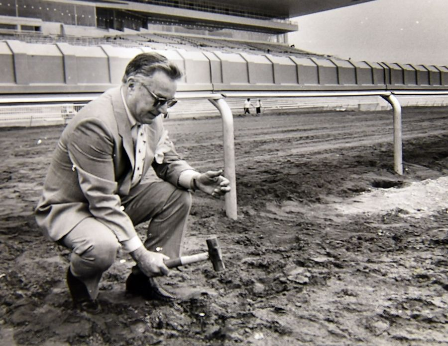 Daily Herald file photoChairman Dick Duchossois pounds the ceremonial golden spike to comemmorate the new inner rail at The Arlington International Racecourse in May of 1989. The grandstand was rebuilt and opened that June after a devastating fire four years earlier.