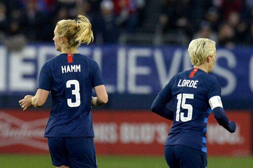 292a7dddf United States midfielder Samantha Mewis (3) and forward Megan Rapinoe (15)  play