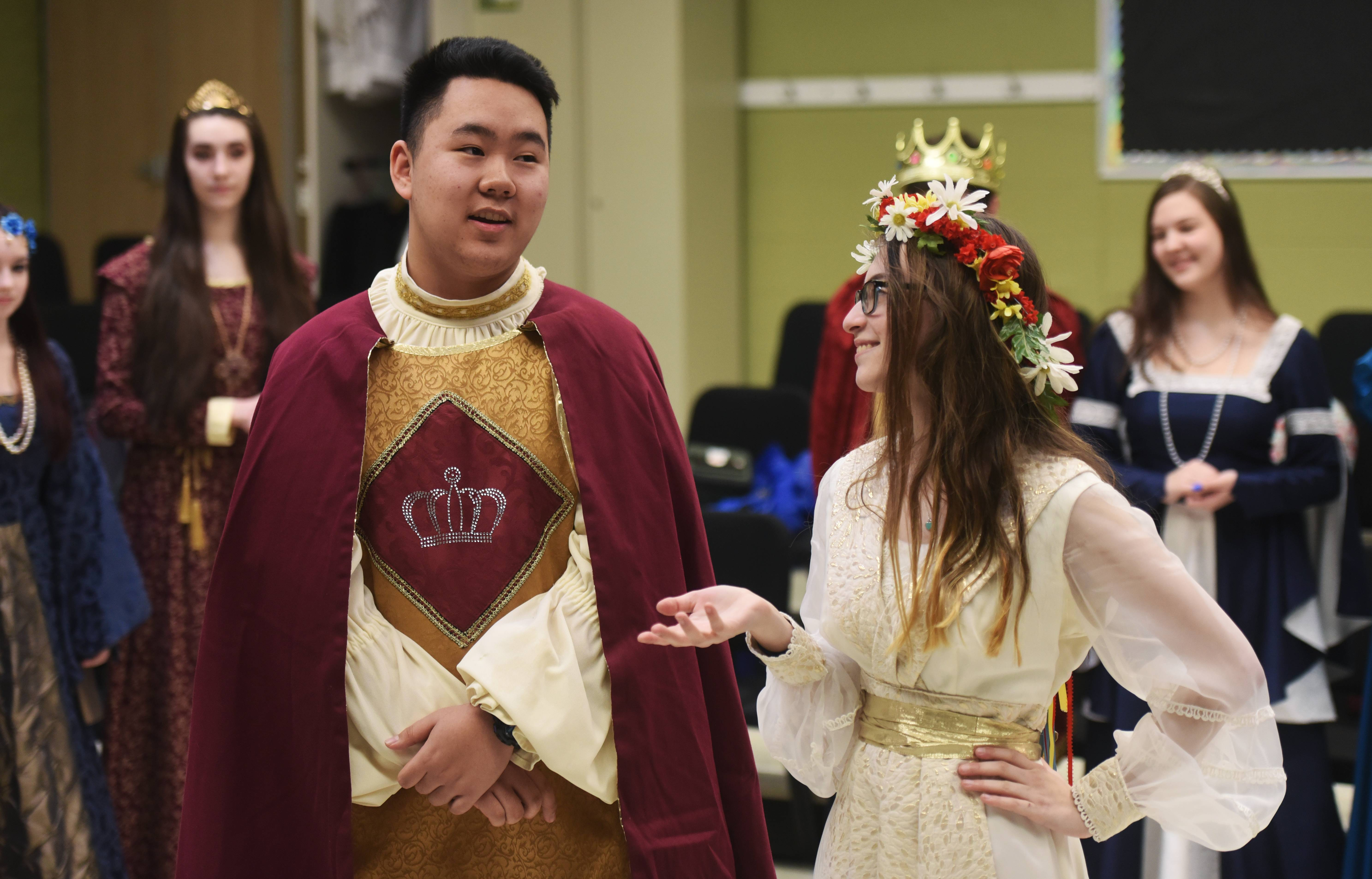 Shawn Zhu, who plays Prince Rowan, and Mary Baldino, who plays Adelaide, perform lines of dialogue Tuesday during a dress rehearsal for the Stevenson High School Madrigal dinner.