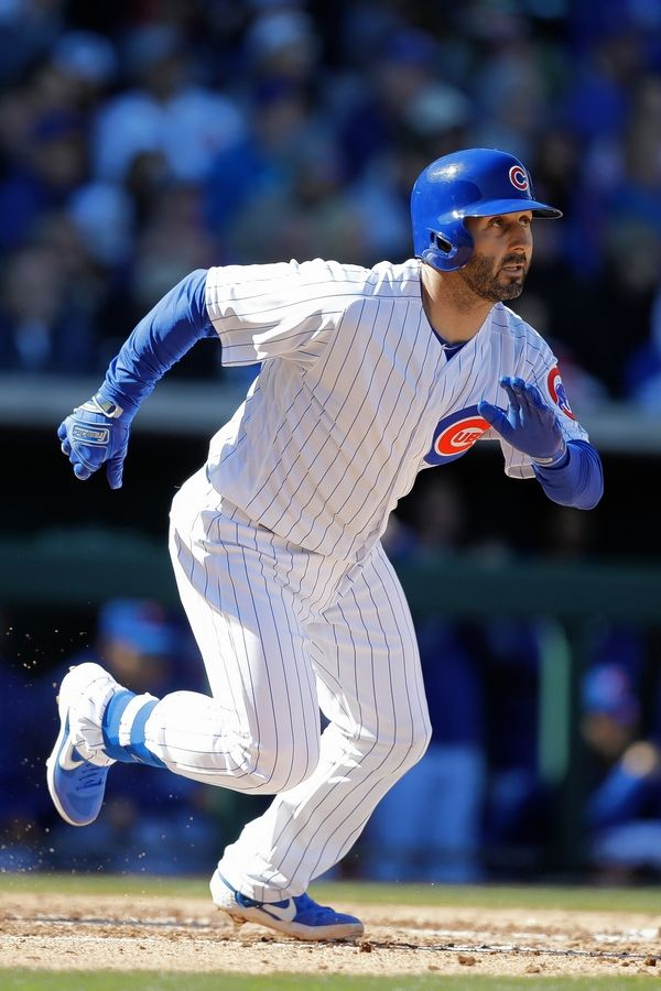 Chicago Cubs' Daniel Descalso hits during a spring training baseball game against the Milwaukee Brewers, Saturday, Feb. 23, 2019, in Mesa, Ariz.