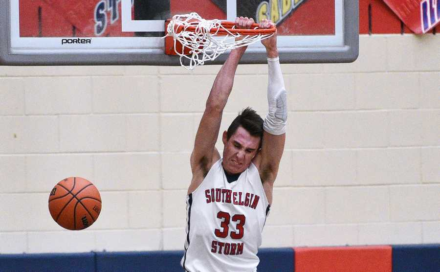 South Elgin s Vincent Miszkiewicz (33) hangs on the rim after a dunk as  Hampshire s 75bd5bb3f