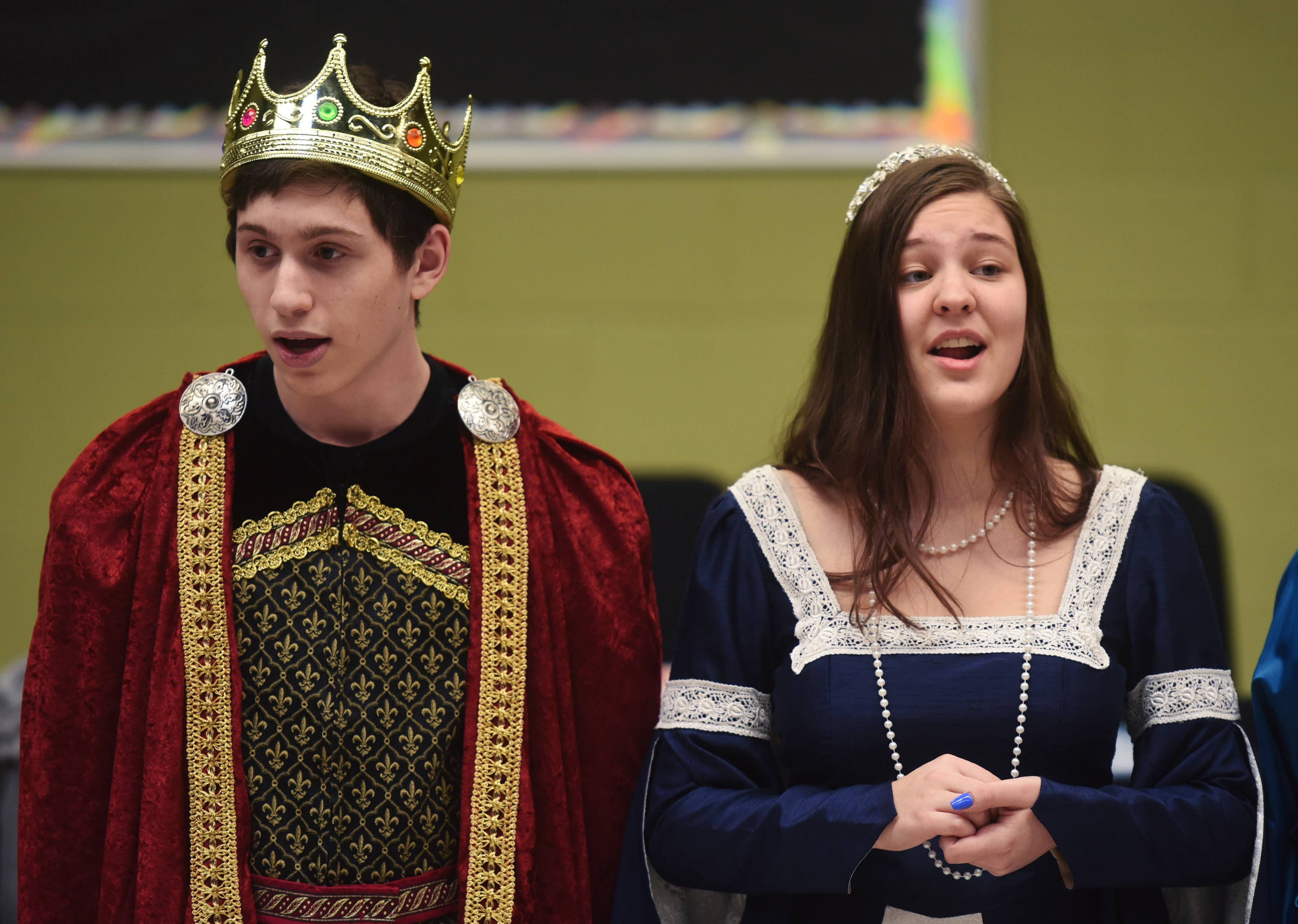 Nick Filerman, left, who plays King Fletcher, and Donna Ilyukh, who plays Queen Ivy, sing during a dress rehearsal Tuesday for the Stevenson High School Madrigal dinner, set for Sunday in Buffalo Grove.