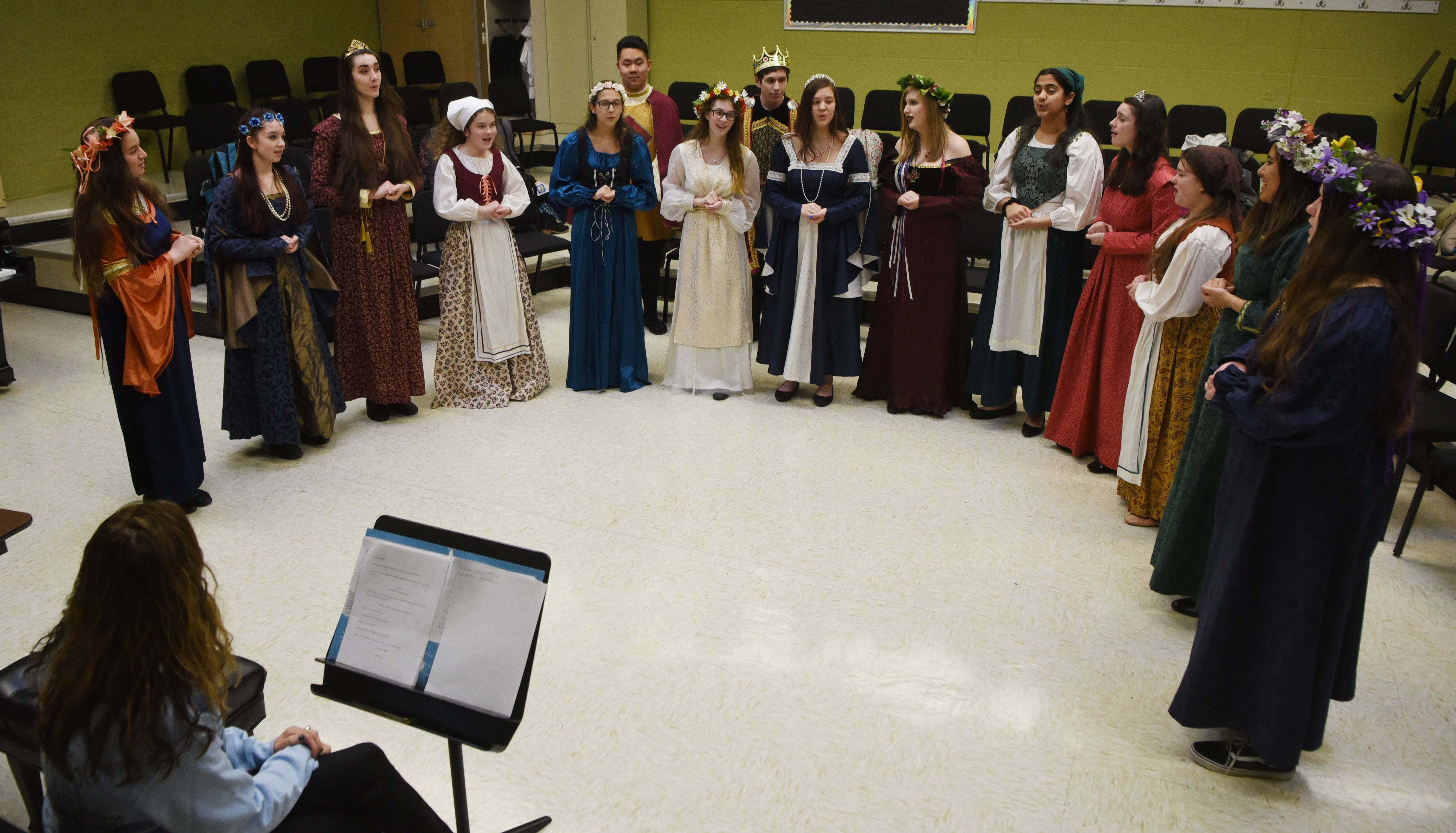 The Madrigal Singers perform Tuesday under the direction of Ellen Singer. The troupe will host its annual Madrigal dinner Sunday in Buffalo Grove.