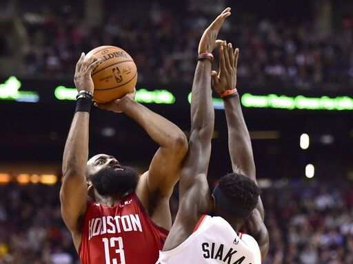 d2f2a70fd02 Houston Rockets guard James Harden (13) shoots over Toronto Raptors forward  Pascal Siakam during