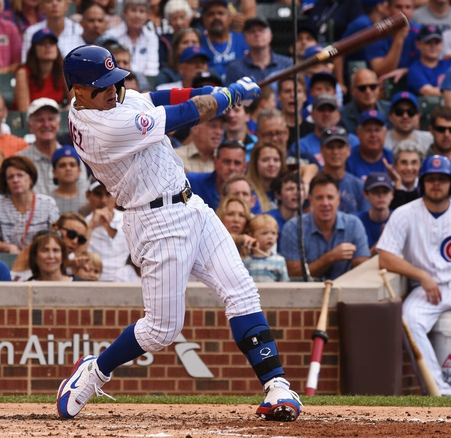 Javier Baez of the Chicago Cubs drives in Addison Russell with an RBI single during the second inning of a 2016 win. Things will get really interesting if Russell completes his suspension in good graces and returns to the roster.