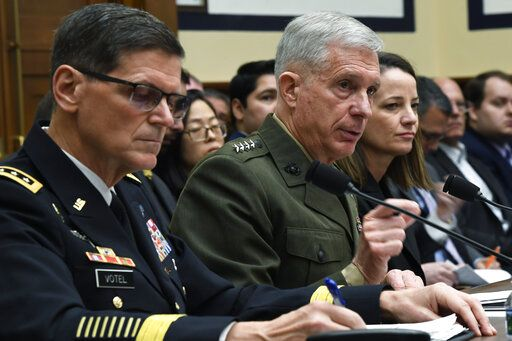 U.S. Africa Command Commander Gen. Thomas Waldhauser, center, flanked by U.S. Central Command Commander Gen. Joseph Votel, left, and Acting Assistant Secretary of Defense for International Security Affairs Kathryn Wheelbarger, right, testifies before the House Armed Services Committee on Capitol Hill in Washington, Thursday, March 7, 2019.