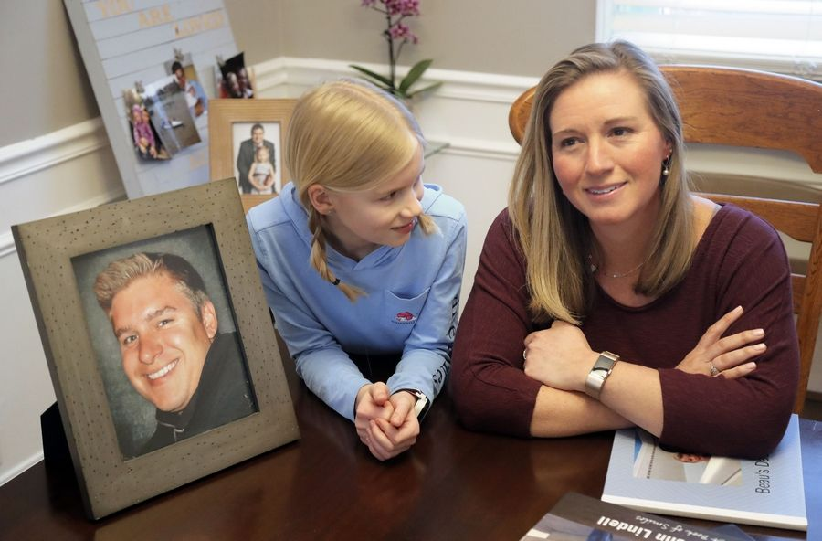 Although he died in 2015, Bob Lindell still has a place in his family's home in Libertyville. His widow Lisa Lindell, left, and her daughter Julia, 10, reminisce often.