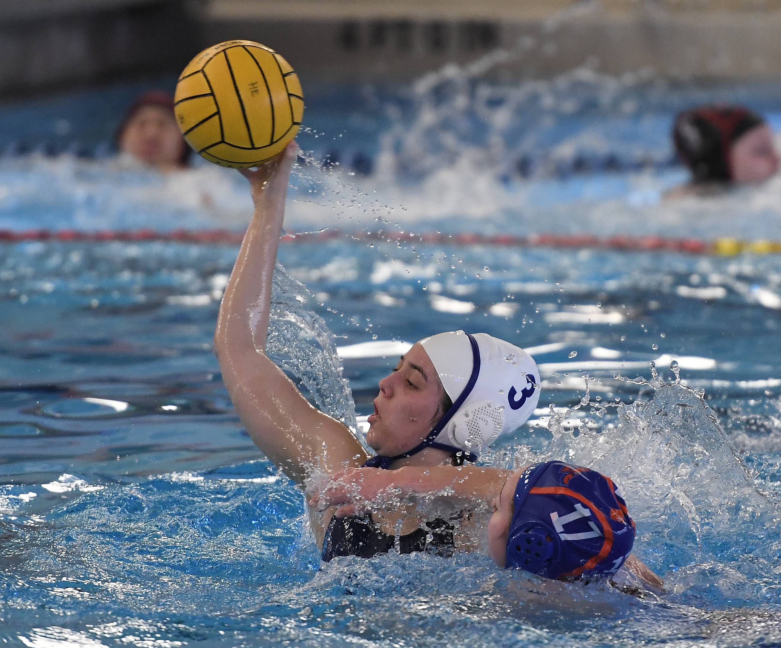 Vernon Hills' Allie Pappas fires the ball as Hoffman Estates' Ak Hughes applies pressure during the Hoffman Estates girls water polo invite on Saturday.