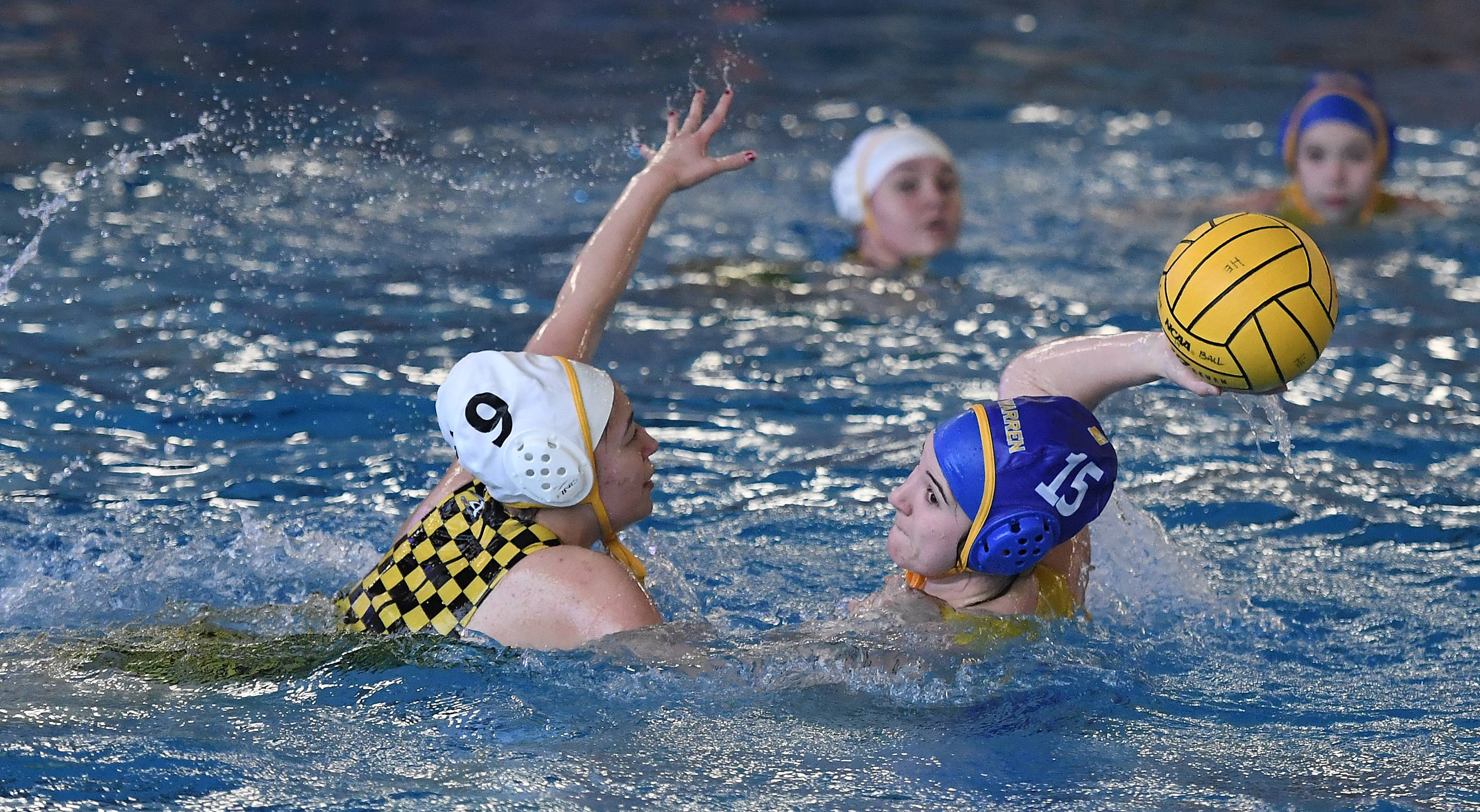 Warren's Anna Richey fires towards the goal as Andrew's Ella Lim defends during the Hoffman Estates girls water polo invite on Saturday.