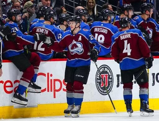 a953db8e2a9 Colorado Avalanche center Nathan MacKinnon (29) celebrates a goal against  the Buffalo Sabres with