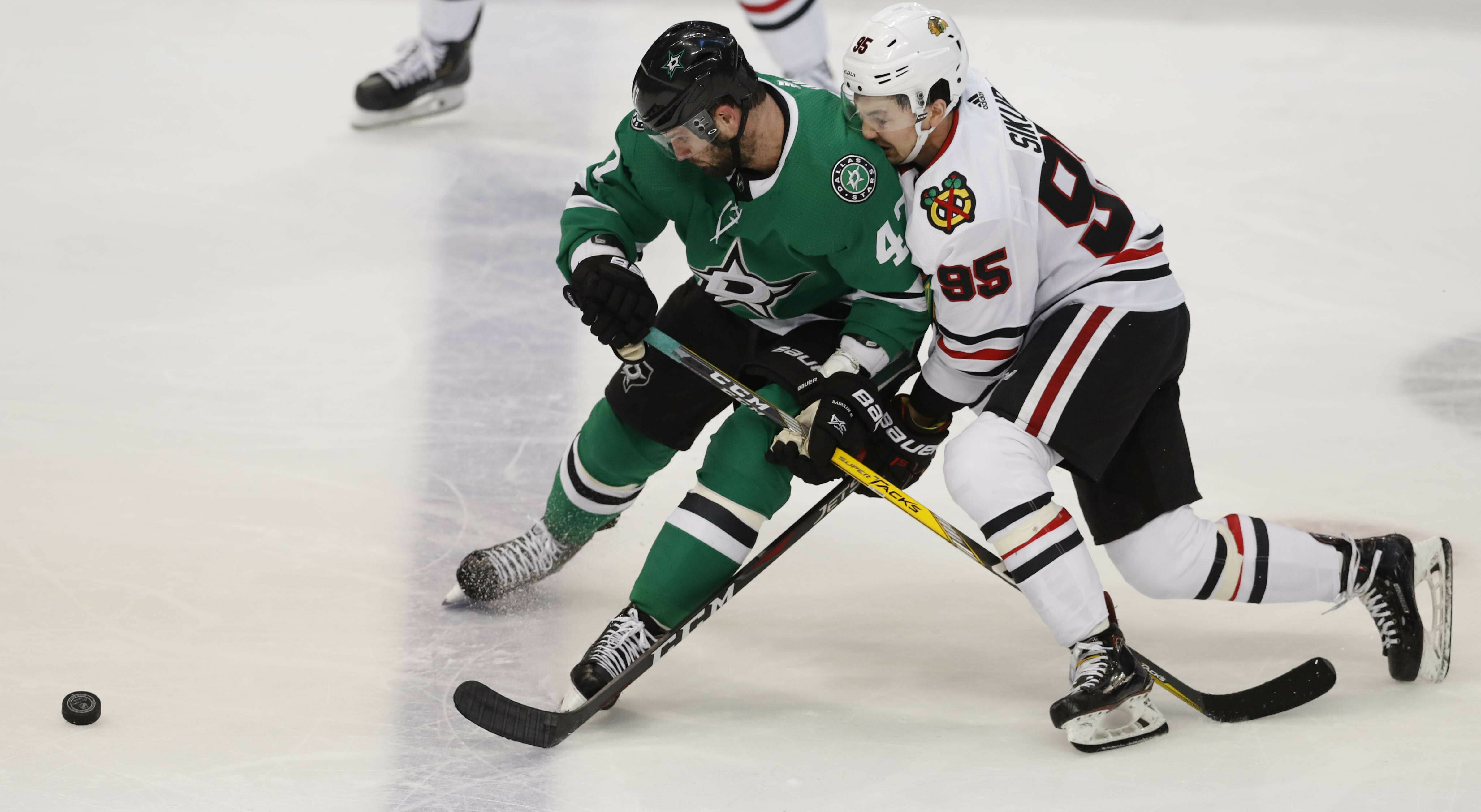 Chicago Blackhawks right wing Dylan Sikura (95) and Dallas Stars right wing Alexander Radulov (47) skate for control of the puck during the second period of an NHL hockey game in Dallas, Saturday, March 9, 2019.