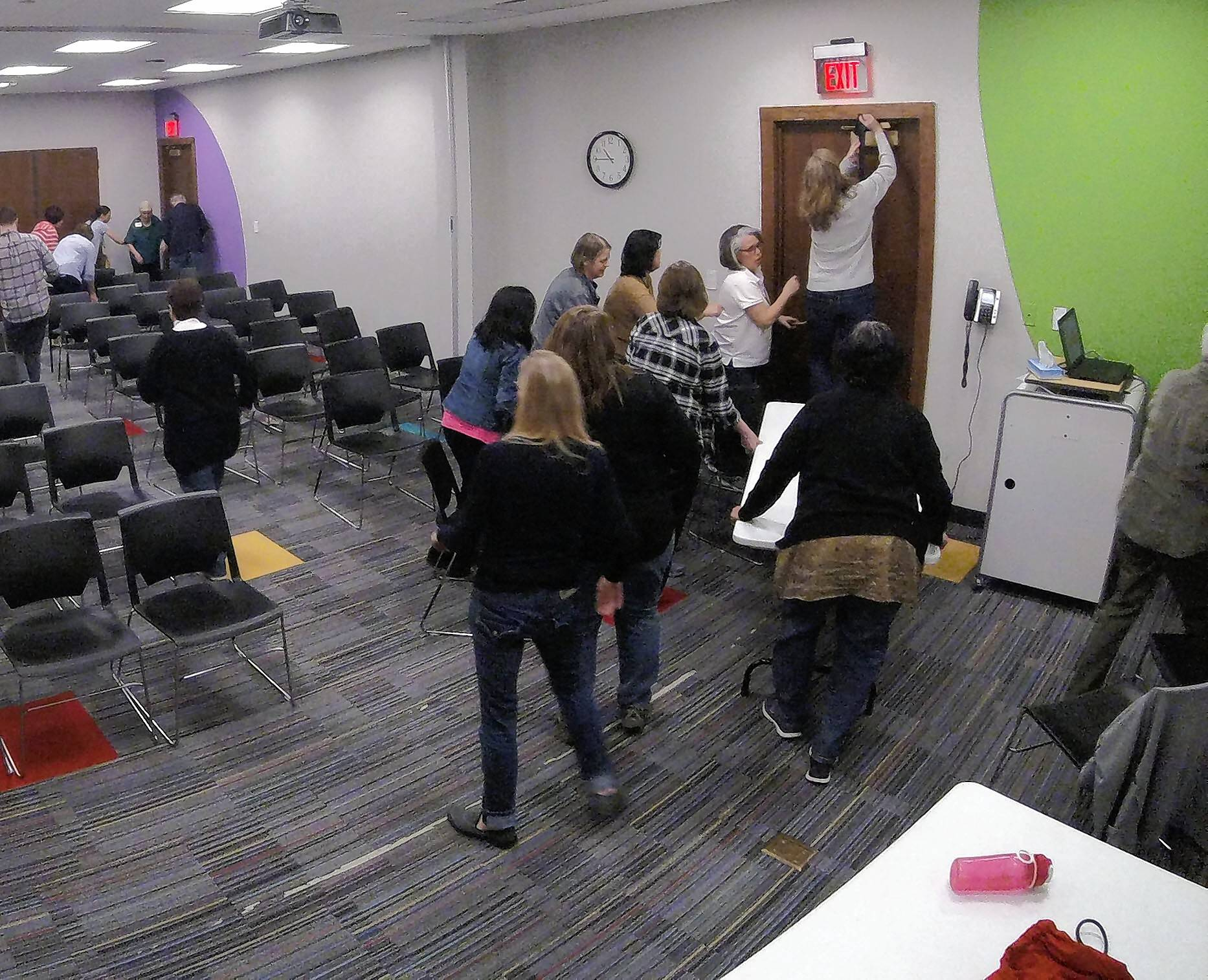 Naperville Public Library employees practice securing themselves in a room during an active shooter training session led by local police.
