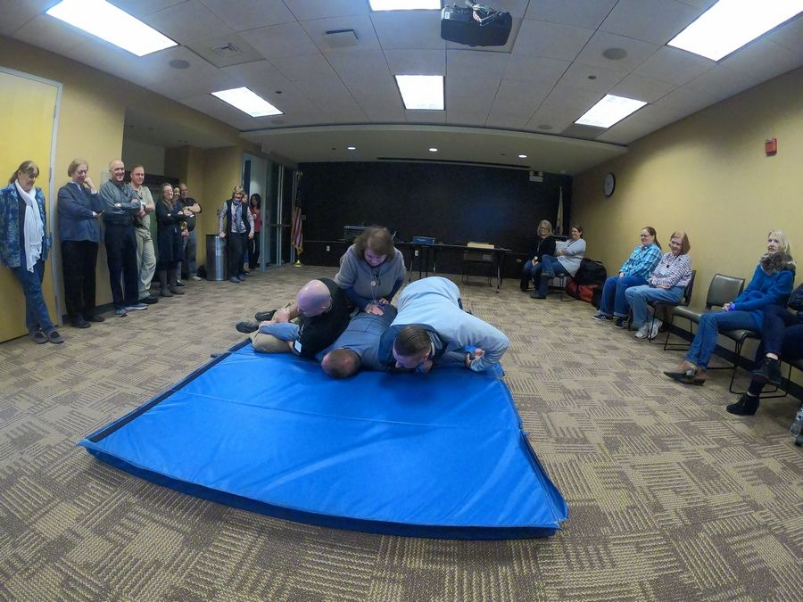 Naperville Public Library employees practice taking down a gunman during an active shooter training session led by local police.