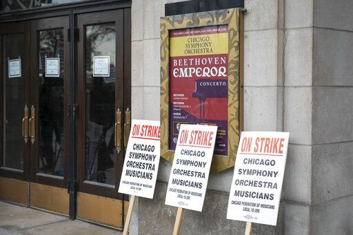 Picket signs used by striking musicians of the Chicago Symphony Orchestra are left outside the doors of Orchestra Hall on Michigan Avenue, Monday morning, March 11, 2019. (Ashlee Rezin/Chicago Sun-Times via AP)