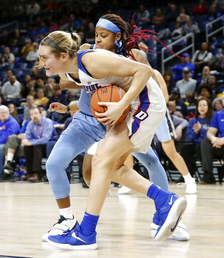 DePaul guard Kelly Campbell, front, steals the ball from Marquette guard Danielle King during the first half of an NCAA college basketball game in the Big East women's tournament final Tuesday, March 12, 2019, in Chicago.