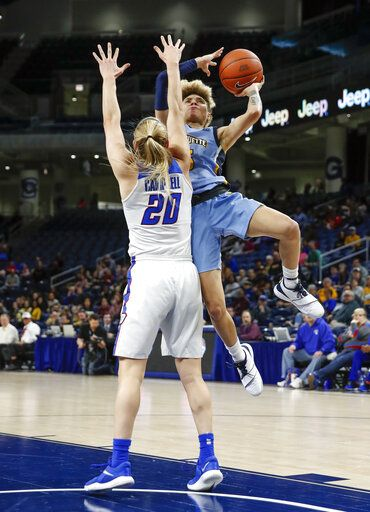 Marquette guard Natisha Hiedeman (5) shoots against DePaul guard Kelly Campbell (20) during the first half of an NCAA college basketball game in the Big East women's tournament final Tuesday, March 12, 2019, in Chicago.