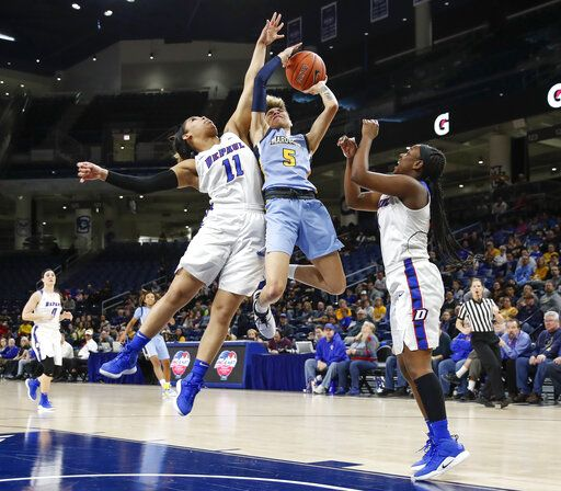 Marquette guard Natisha Hiedeman (5) shoots as she is fouled by DePaul guard Sonya Morris (11) during the first half of an NCAA college basketball game in the Big East women's tournament final Tuesday, March 12, 2019, in Chicago.