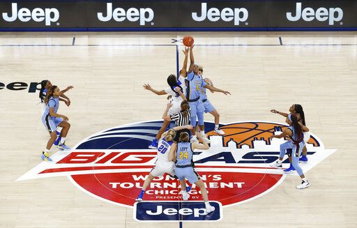 DePaul forward Mart'e Grays (35) and Marquette guard Allazia Blockton (11) go for the opening tip of an NCAA college basketball game in the Big East women's tournament final Tuesday, March 12, 2019, in Chicago.