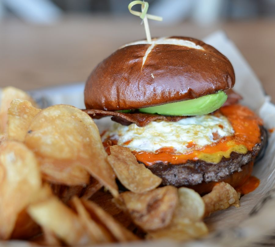 The Chicago Fire burger from Timothy O'Toole's Pub comes topped with bacon, a fried egg, avocado, cheddar and Irish ghost wing sauce.