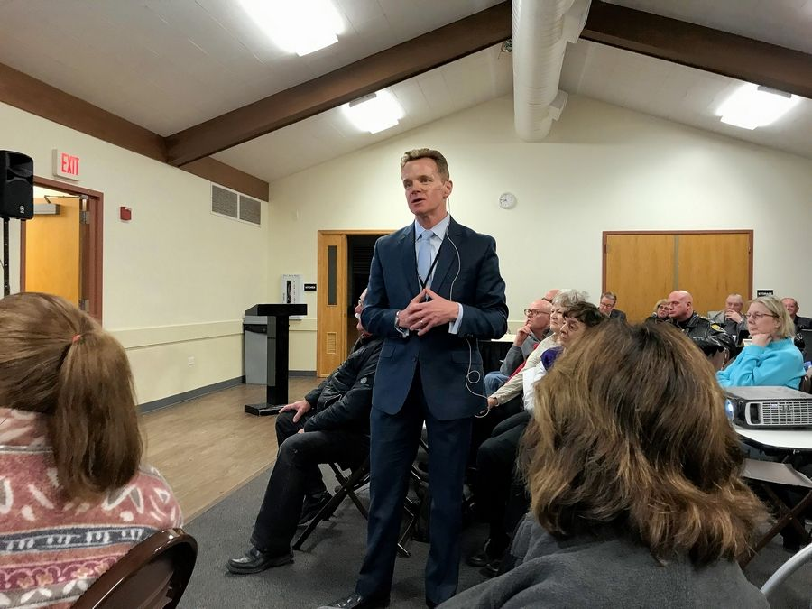 Mount Prospect Public Works Director Sean Dorsey discusses flooding issues on the village's northeast side during a meeting with residents Tuesday at the Burning Bush Community Center.