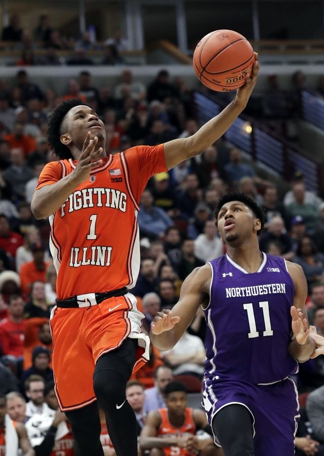 Illinois guard Trent Frazier, left, drives to the basket as Northwestern guard Anthony Gaines looks on during the second half of an NCAA college basketball game in the first round of the Big Ten Conference tournament in Chicago, Wednesday,
