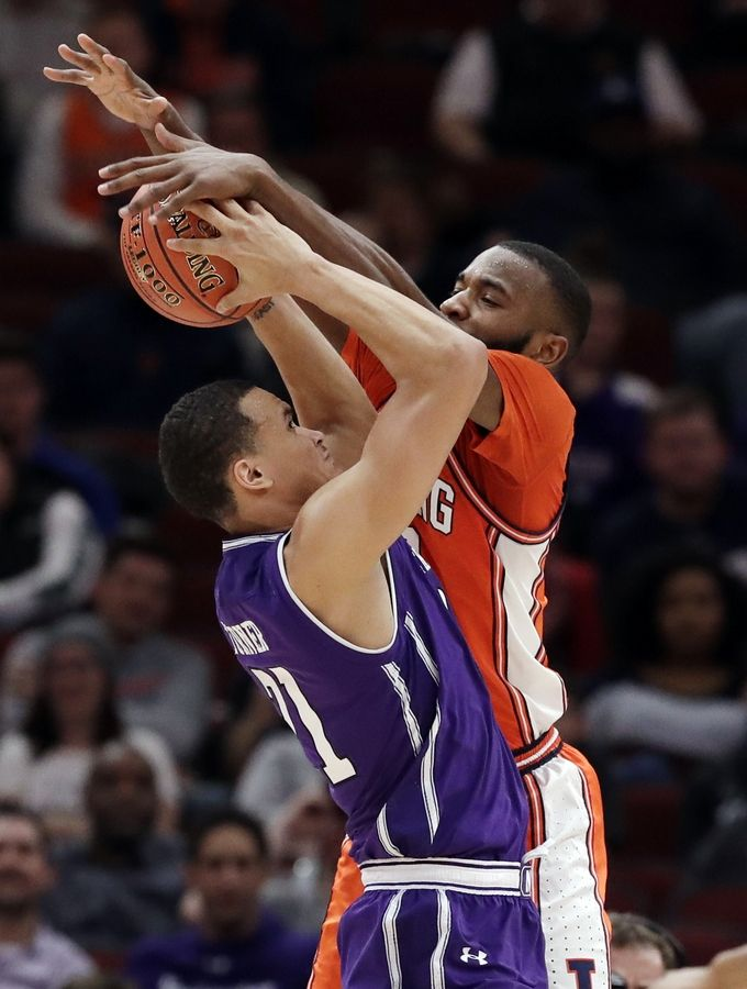Illinois guard Aaron Jordan, right, blocks a shot by Northwestern forward A.J. Turner during the second half of an NCAA college basketball game in the first round of the Big Ten Conference tournament in Chicago.