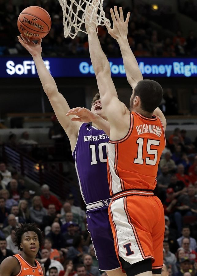 Northwestern forward Miller Kopp, left, shoots against Illinois forward Giorgi Bezhanishvili during the first half of an NCAA college basketball game in the first round of the Big Ten Conference tournament in Chicago, Wednesday, March 13, 2019.