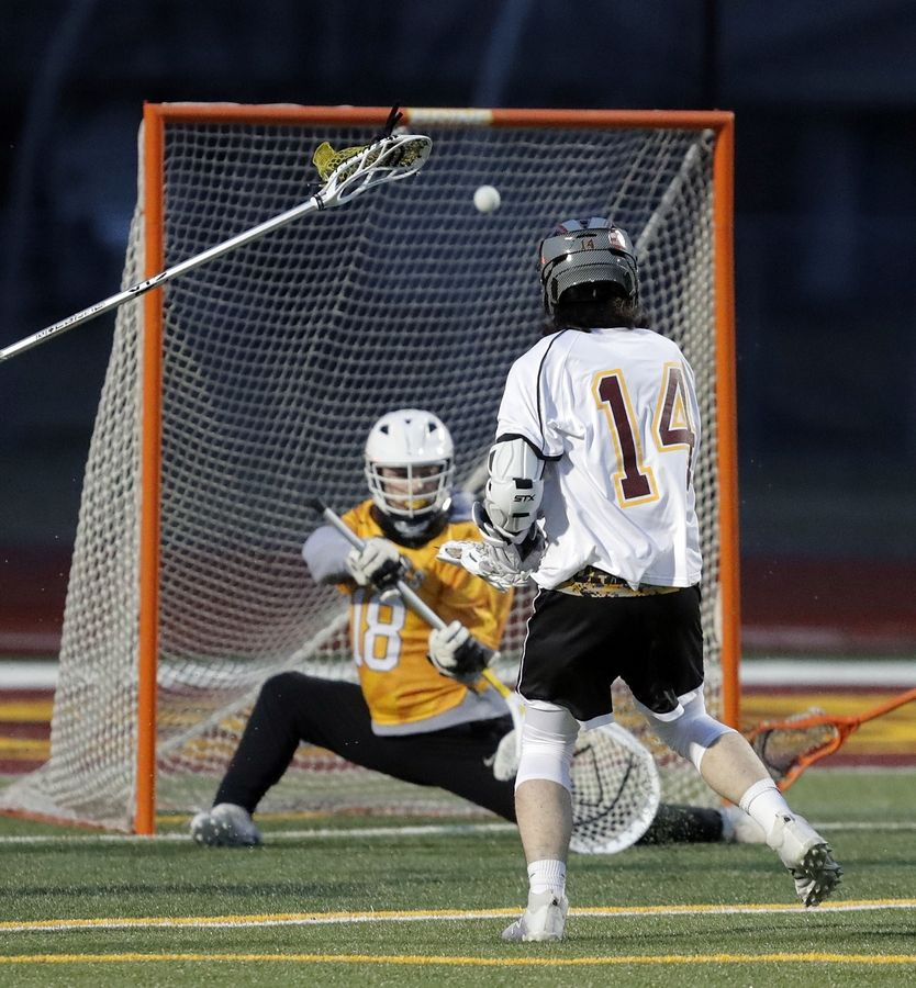 Schaumburg's Nick Woodworth scores on Jacobs' Cameron Mollsen during boys lacrosse at Schaumburg High School Wednesday.