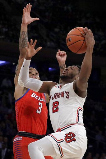 St. John's guard Shamorie Ponds (2) goes up for a shot against DePaul guard Devin Gage (3) during the first half of an NCAA college basketball game in the Big East men's tournament, Wednesday, March 13, 2019, in New York.