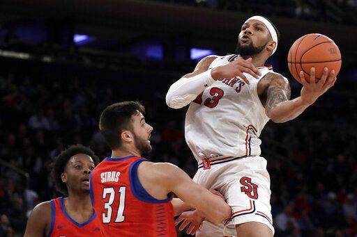 St. John's forward Marvin Clark II (13) goes up for a shot against DePaul guard Max Strus (31) and forward Femi Olujobi during the first half of an NCAA college basketball game in the Big East men's tournament Wednesday, March 13, 2019, in New York.