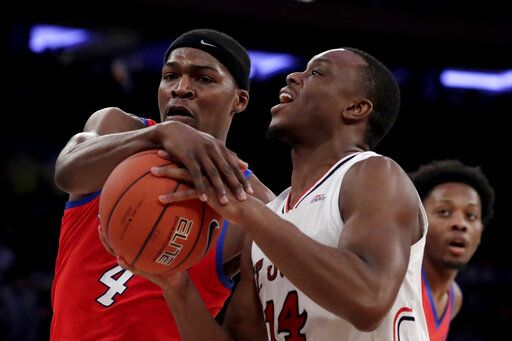 St. John's guard Mustapha Heron (14) tries for a shot against DePaul forward Paul Reed (4) during the first half of an NCAA college basketball game in the Big East men's tournament, Wednesday, March 13, 2019, in New York.