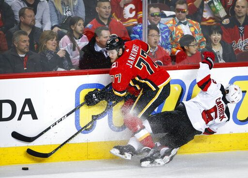 check out 090b3 cba7a Gaudreau's big night pushes Flames past Devils 9-4