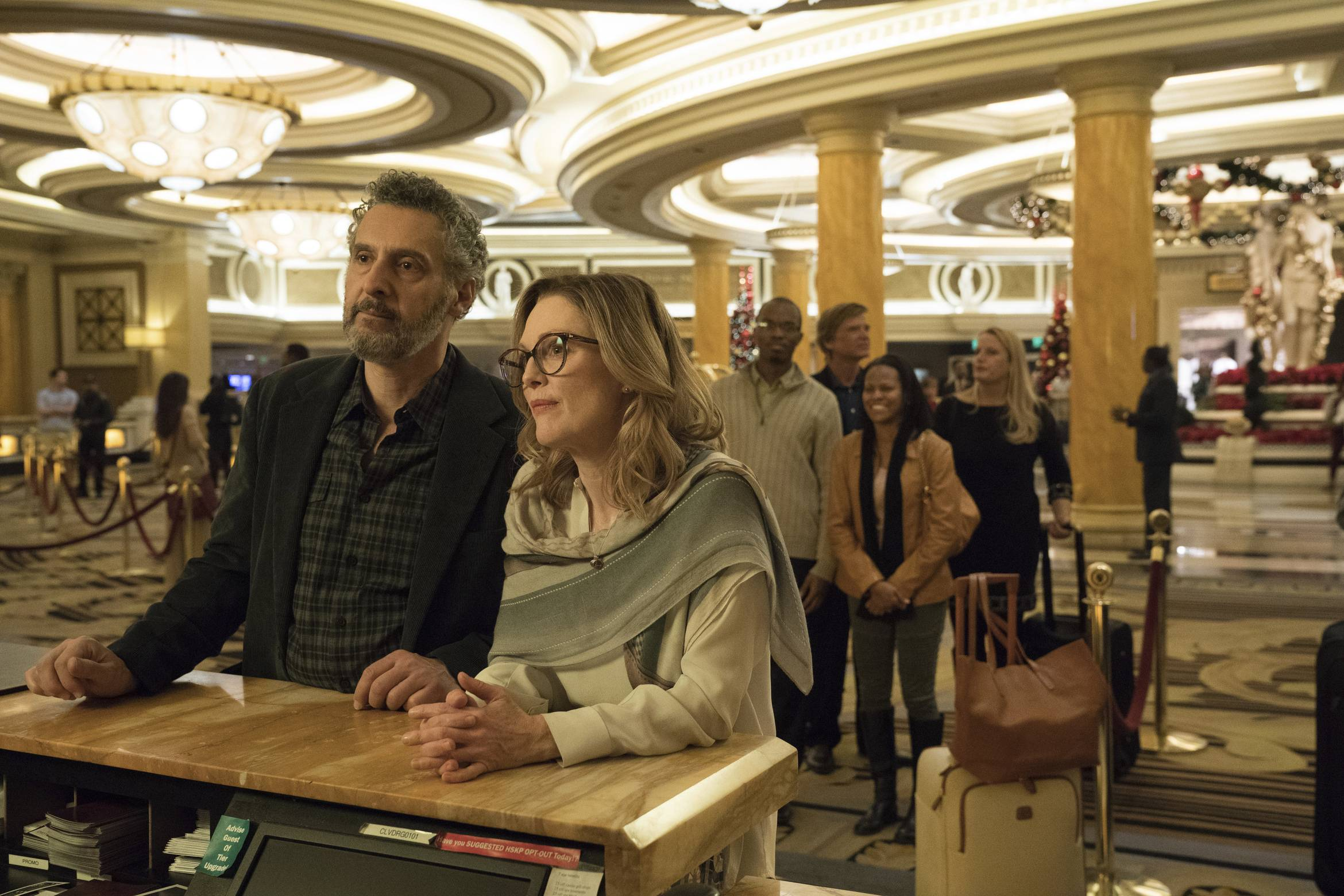 "Arthur (John Turturro) falls for Gloria (Julianne Moore) but goes running every time his ex-wife calls in ""Gloria Bell."""