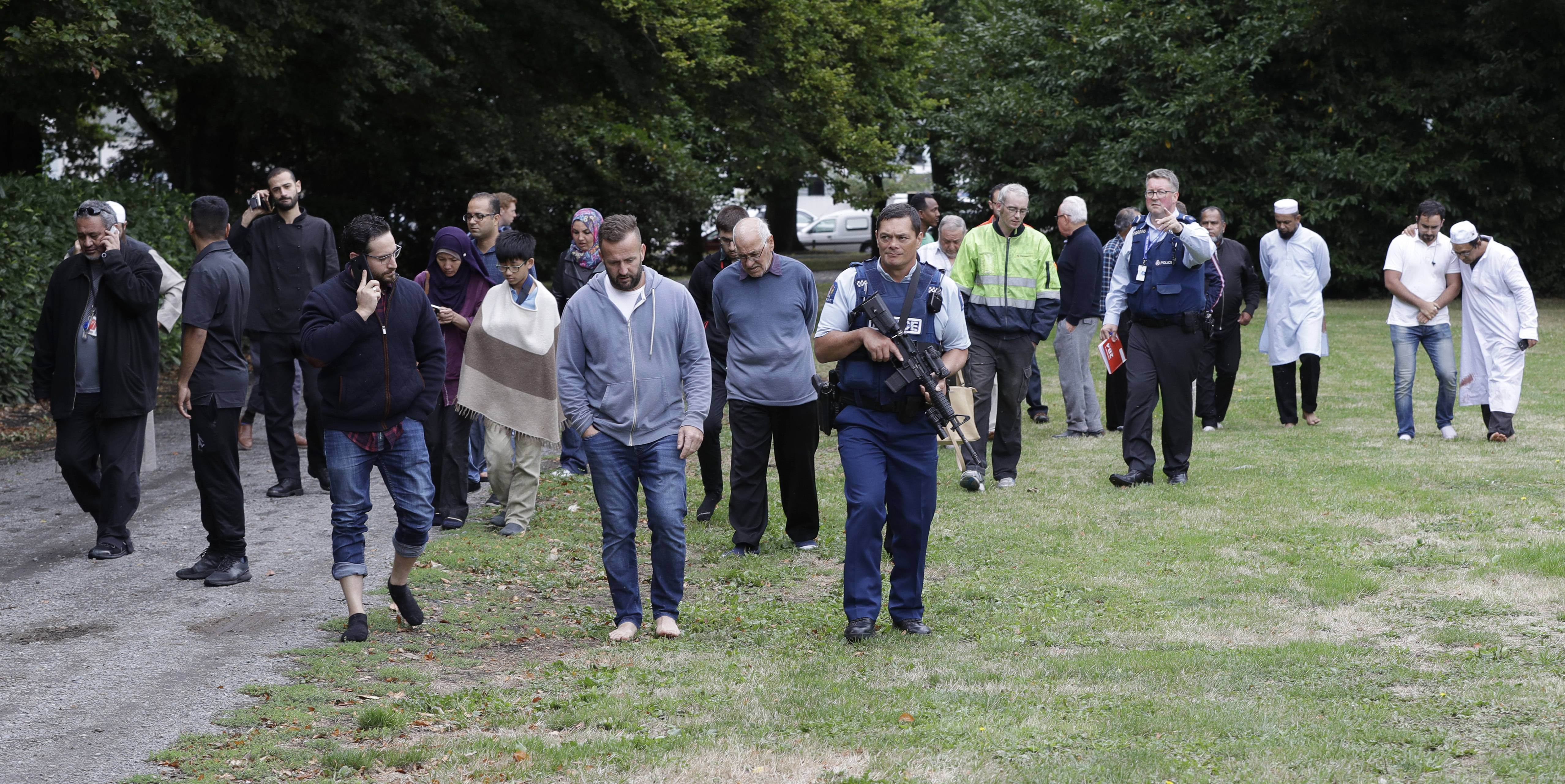 Police escort witnesses away from a mosque Friday in central Christchurch, New Zealand. Multiple people were killed in mass shootings at two mosques full of people attending Friday prayers, as New Zealand police warned people to stay indoors as they tried to determine if more than one gunman was involved.