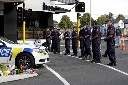 Police officers prepare to search the area near the Masjid Al Noor mosque, site of one of the mass shootings at two mosques in Christchurch, New Zealand, Saturday, March 16, 2019.