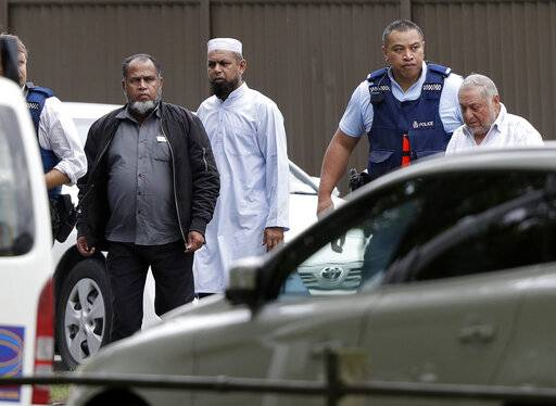 Police escort men from a mosque in central Christchurch, New Zealand, Friday, March 15, 2019. Multiple people were killed in mass shootings at two mosques full of people attending Friday prayers, as New Zealand police warned people to stay indoors as they tried to determine if more than one gunman was involved.
