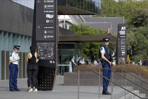 Police stand guard outside the district court building in Christchurch, New Zealand, Saturday, March 16, 2019, where the man believed to be involved in yesterday's mosque shootings will likely appear.