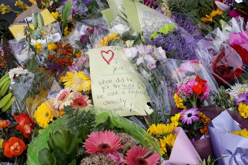 A handwritten message is placed at a makeshift memorial near the Masjid Al Noor mosque in Christchurch, New Zealand, Saturday, March 16, 2019, where one of the two mosque mass shootings at occurred.
