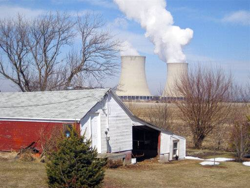 FILE - In this March 16, 2011, file photo, steam escapes from Exelon Corp.'s nuclear plant in Byron, Ill. The nuclear power industry is pushing the Nuclear Regulatory Commission to cut back on inspections at nuclear power plants and throttle back what it tells the public about plant problems.