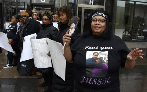 Empire actor Jussie Smollett supporter, Sandra Gentry, right, and others , talk as Smollett arrives at the Leighton Criminal Court Building for his hearing on Thursday, March 14, 2019, in Chicago. Smollett is accused of lying to police about being the victim of a racist and homophobic attack by two men on Jan. 29 in downtown Chicago.