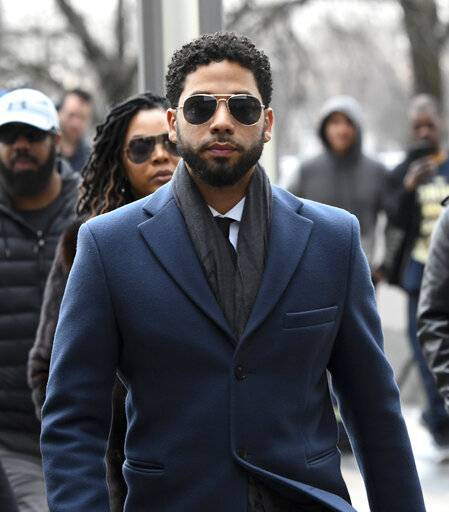 Empire actor Jussie Smollett, center, arrives at the Leighton Criminal Court Building for his hearing on Thursday, March 14, 2019, in Chicago. Smollett is accused of lying to police about being the victim of a racist and homophobic attack by two men on Jan. 29 in downtown Chicago.