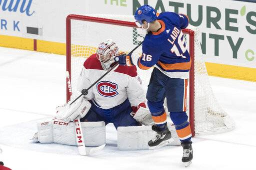 Montreal Canadiens goaltender Carey Price (31) makes a save against New York Islanders left wing Andrew Ladd (16) during the third period of an NHL hockey game, Thursday, March 14, 2019, in Uniondale, N.Y.