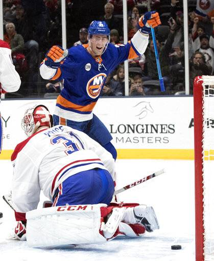 New York Islanders center Brock Nelson (29) reacts after defenseman Adam Pelech (not shown) scored a goal past Montreal Canadiens goaltender Carey Price (31) during the second period of an NHL hockey game, Thursday, March 14, 2019, in Uniondale, N.Y.