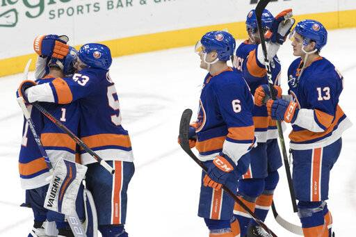 New York Islanders goaltender Thomas Greiss (1) celebrates with his teammates after winning an NHL hockey game against the Montreal Canadiens, Thursday, March 14, 2019, in Uniondale, N.Y.