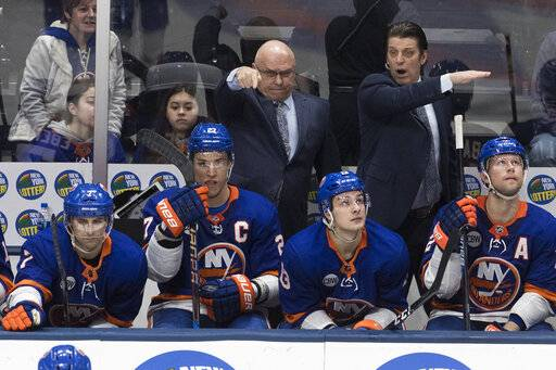 New York Islanders head coach Barry Trotz, back left, gestures during the third period of an NHL hockey game against the Montreal Canadiens, Thursday, March 14, 2019, in Uniondale, N.Y.