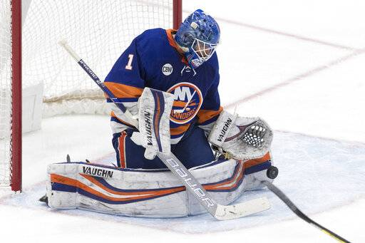New York Islanders goaltender Thomas Greiss makes a save during the third period of the team's NHL hockey game against the Montreal Canadiens, Thursday, March 14, 2019, in Uniondale, N.Y. The Islanders won 2-1.