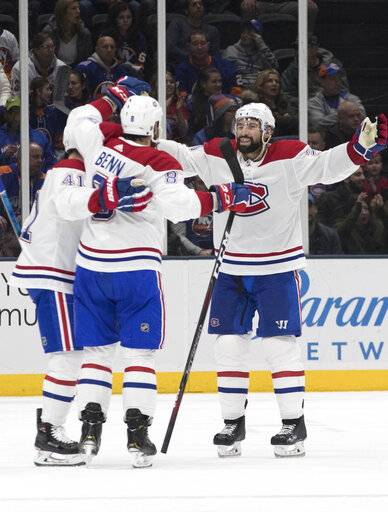 Montreal Canadiens defenseman Jordie Benn, center, celebrates after scoring a goal during the second period of an NHL hockey game against the New York Islanders, Thursday, March 14, 2019, in Uniondale, N.Y.