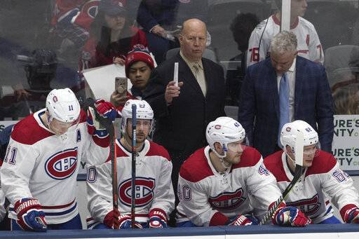 Montreal Canadiens coach Claude Julien, background left, reacts during the third period of the team's NHL hockey game against the New York Islanders, Thursday, March 14, 2019, in Uniondale, N.Y. The Islanders won 2-1.