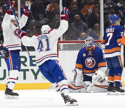 New York Islanders goaltender Thomas Greiss (1) and Montreal Canadiens left wing Paul Byron (41) react after defenseman Jordie Benn (not shown) scored a goal during the second period of an NHL hockey game, Thursday, March 14, 2019, in Uniondale, N.Y.