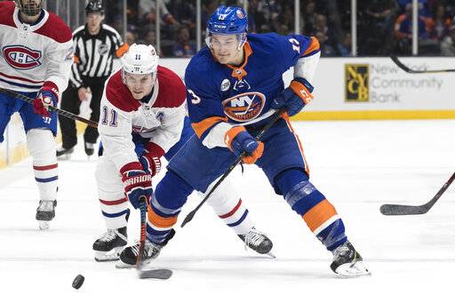 New York Islanders center Mathew Barzal (13) skates against Montreal Canadiens right wing Brendan Gallagher during the first period of an NHL hockey game, Thursday, March 14, 2019, in Uniondale, N.Y.